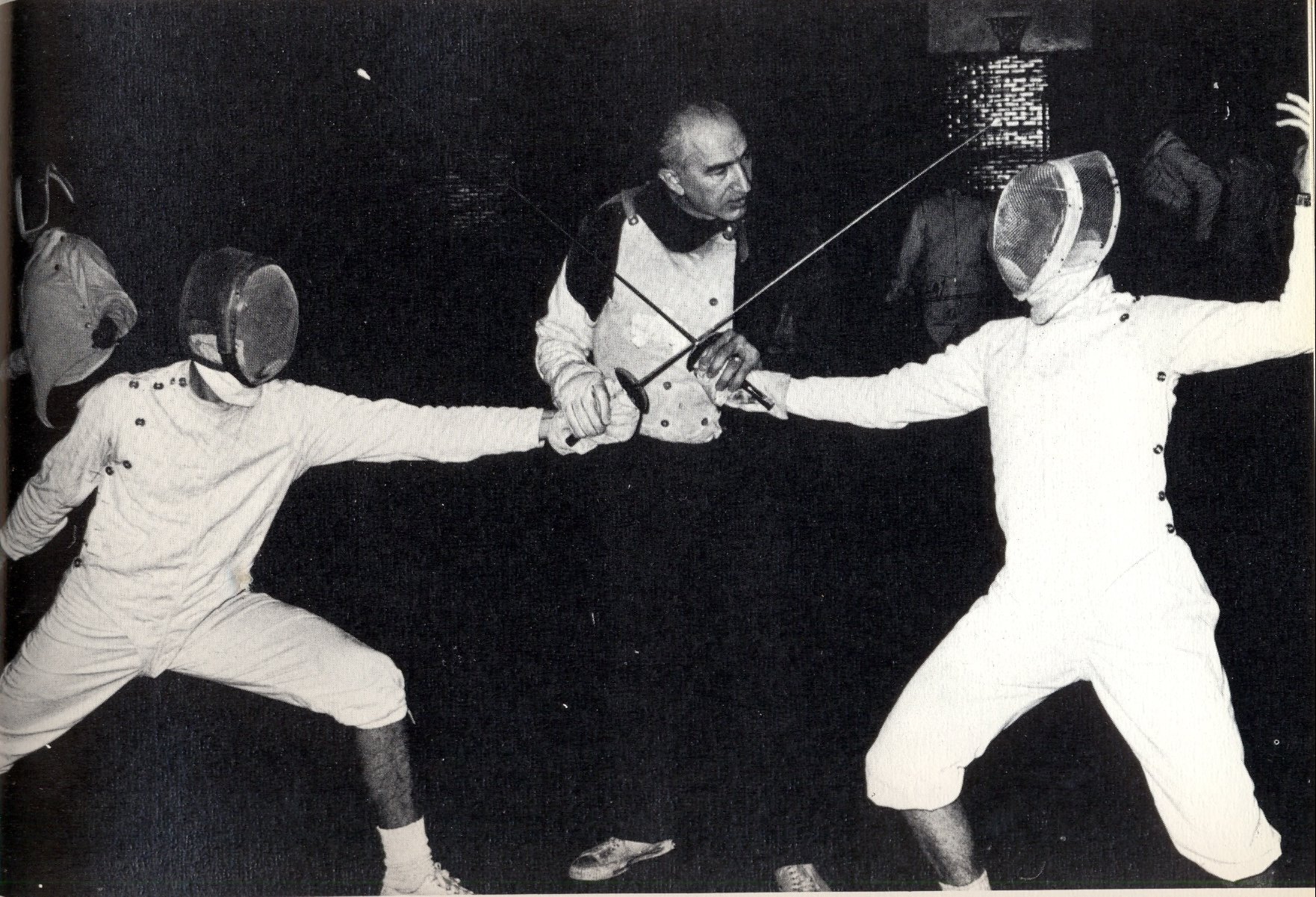 Uncategorized Old Fencing the art of fencing dr arthur tauber center wearing his special protective sleeve and padded vest weighs in during a practice bout old gym basement the